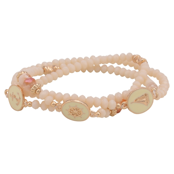 Stretch bracelet featuring ivory beads with seaside disk accents.
