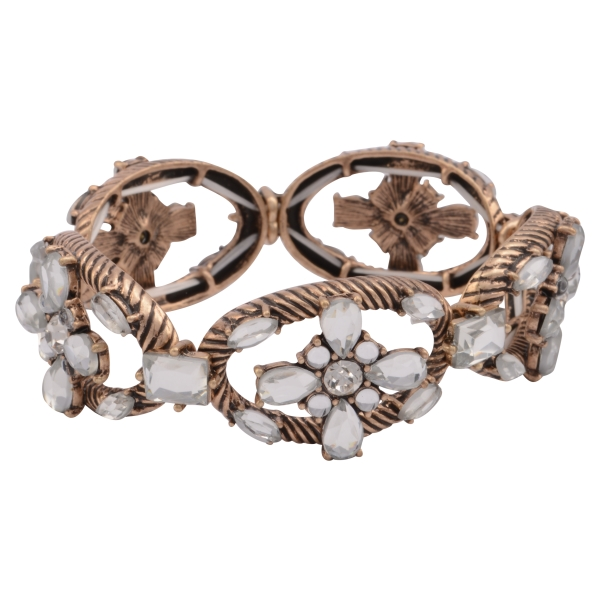 Burnished gold tone stretch bracelet featuring a clear rhinestone floral design.