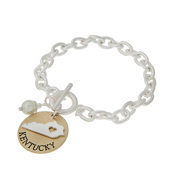 "Matte two tone toggle state bracelet with a ""KENTUCKY"" charm and a faux pearl accent. Approximately 8"" in length."