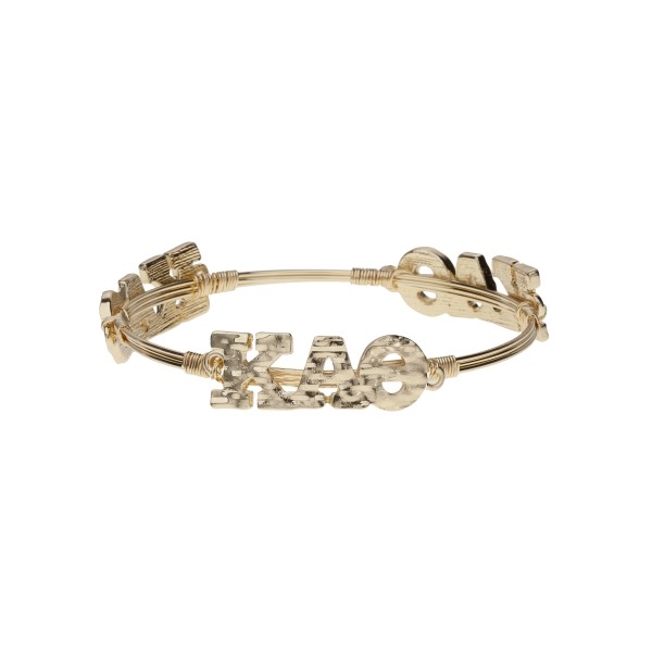 Gold tone Kappa Alpha Theta wire wrapped bangle bracelet.