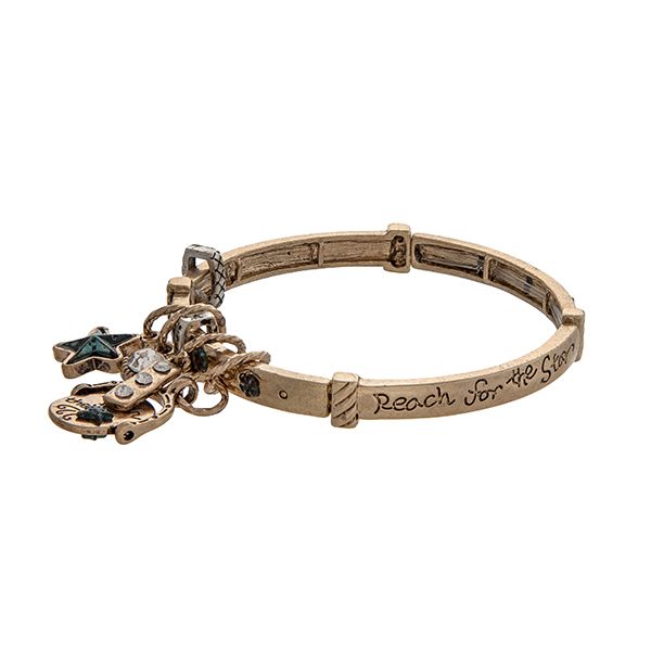 """Gold tone stretch bangle bracelet stamped """"Reach for the Star"""" displaying a star charm and a bar with rhinestones."""