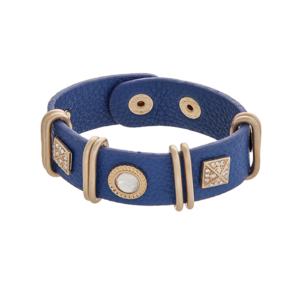 """Royal blue soft faux leather snap bracelet with rhinestone studs, pave squares, and gold tone rings. Approximately 8"""" in length."""