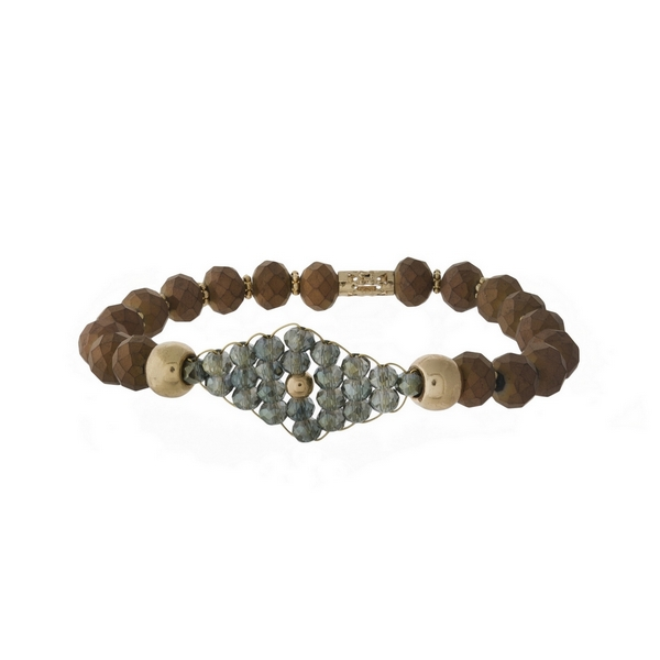 Bronze beaded stretch bracelet with an iridescent beaded, wire wrapped focal.