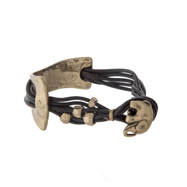 Brown and gold tone leather cord bracelet with a hammered curved bar and an elephant hook.