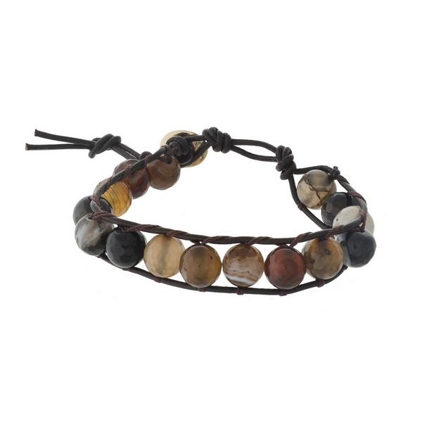 Tan cord bracelet with brown colored beads and a button closure.
