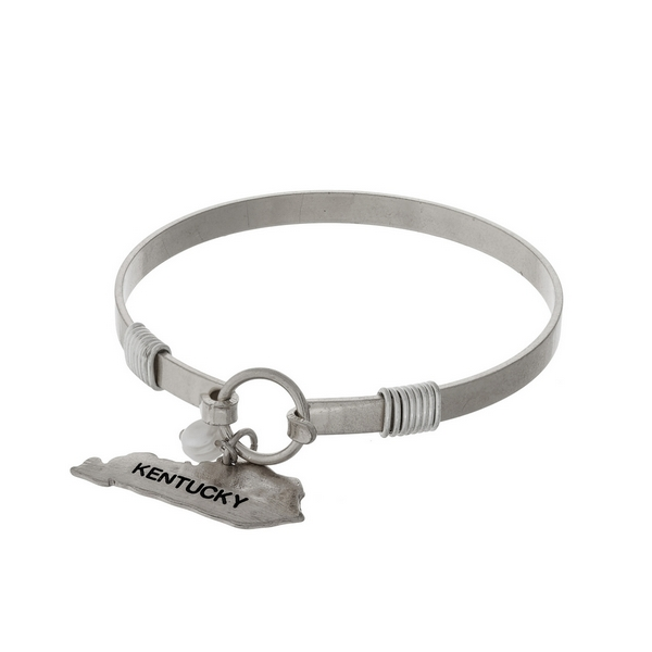 Silver tone bangle bracelet with a Kentucky shaped charm and a pearl bead accent.