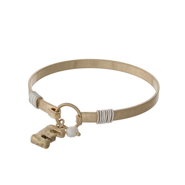 Gold tone bangle bracelet with a hook closure, a block 'E' charm, and a pearl bead accent.