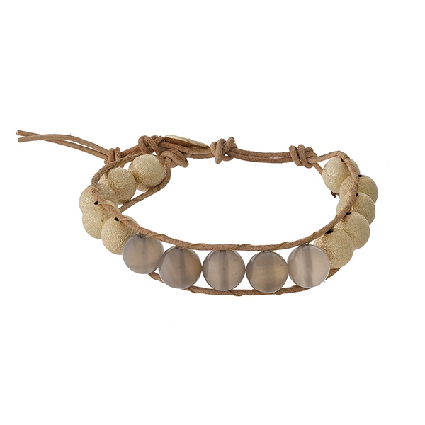 Brown cord bracelet with gray and gold tone beads and a button closure.