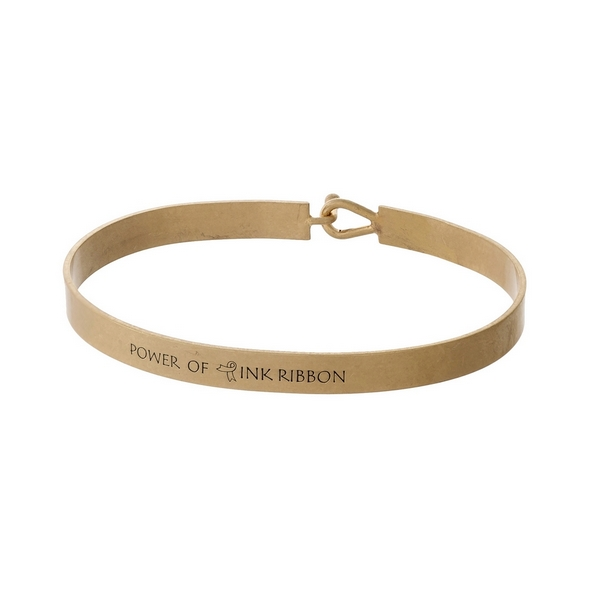 """Gold tone, brass bangle bracelet stamped with """"Power of Pink Ribbon."""""""