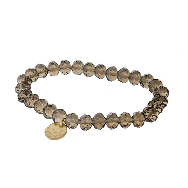 Charcoal gray faceted bead stretch bracelet with a hammered gold tone circle charm.