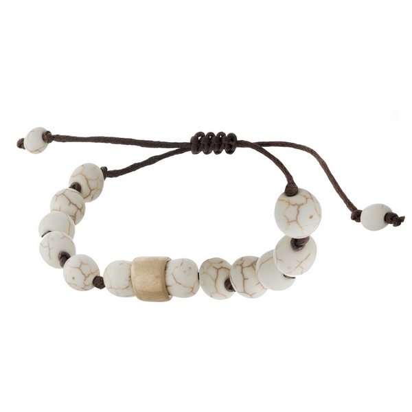 Brown cord bracelet with ivory natural stone beads, a gold tone bead accents and a pull-tie closure.