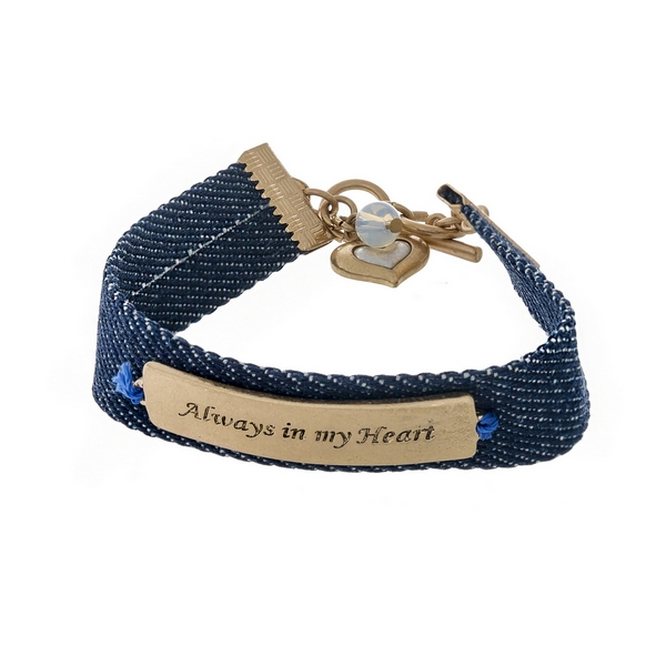 "Denim bracelet featuring a gold tone bar stamped with ""Always in my Heart"" and a toggle closure."