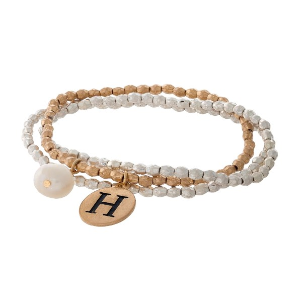 Two tone stretch bracelet with a block 'H' initial and freshwater pearl bead charm.