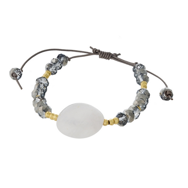 Hematite and gold tone beaded pull-tie bracelet featuring a natural stone focal. Handmade in the USA.