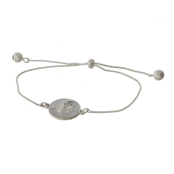 "Dainty silver tone pull-tie bracelet with two birds on one side and the other side is stamped with ""Love is being with you."""