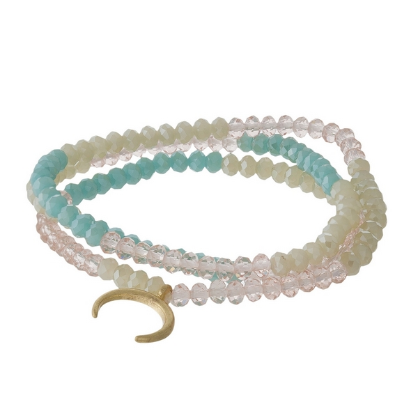 Mint green, pale pink and opal, beaded three piece stretch bracelet set featuring a gold tone horn charm.