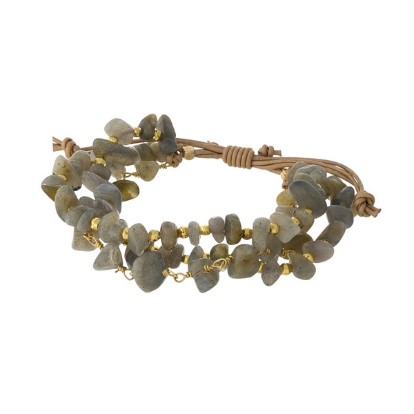 Tan cord, pull-tie bracelet featuring three rows of gray chipstones and gold tone accents. Handmade in the USA.