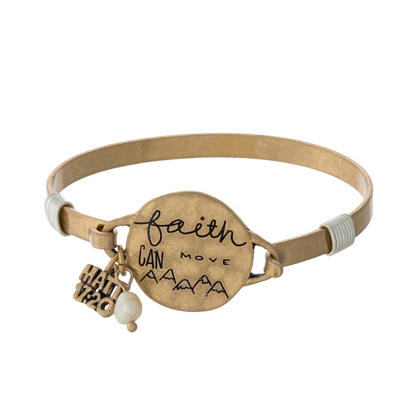 "Gold tone bangle bracelet with a circle focal stamped with ""Faith can move mountains."""