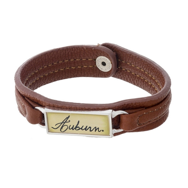 "Officially licensed, Auburn University brown faux leather snap bracelet with a silver tone bar saying ""Auburn."""