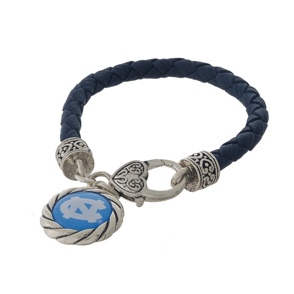 Officially licensed, University of North Carolina faux leather bracelet with a silver tone clasp and a logo charm.