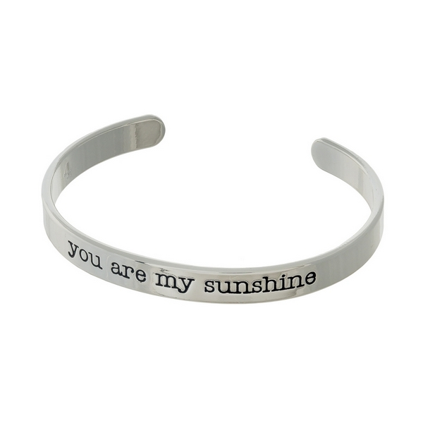 """Silver tone cuff bracelet stamped with """"you are my sunshine."""""""