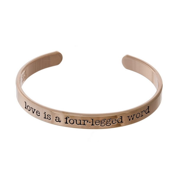 """Rose gold tone cuff bracelet stamped with """"love is a four-legged word."""""""