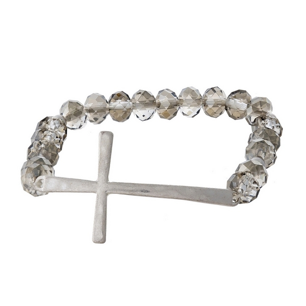 Gray beaded stretch bracelet with a matte silver tone cross focal.