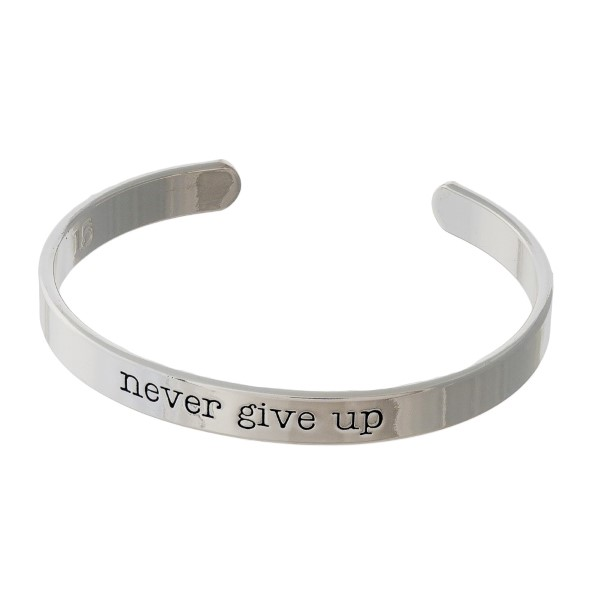 """Silver tone cuff bracelet stamped with """"never give up."""""""
