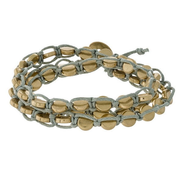 Gray wrap bracelet with gold tone beads and a button closure.