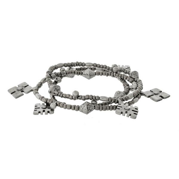 Silver tone three piece stretch bracelet set with bohemian charms.