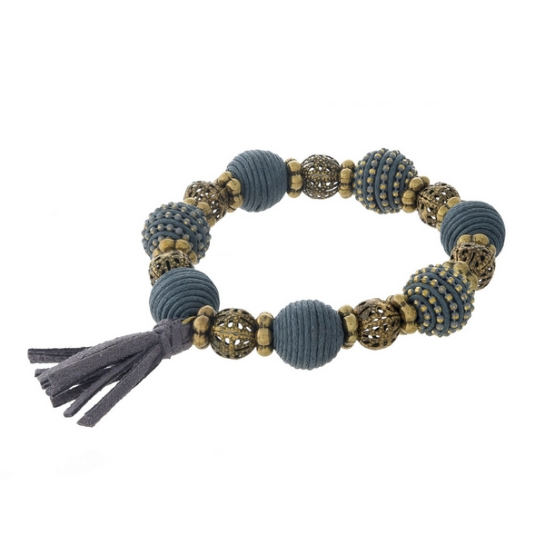 Gray thread wrapped and burnished gold tone, stretch bracelet with a tassel accent.