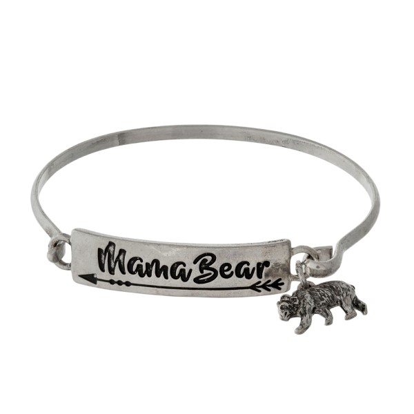"Metal bangle bracelet stamped with ""Mama Bear"" and a bear charm."