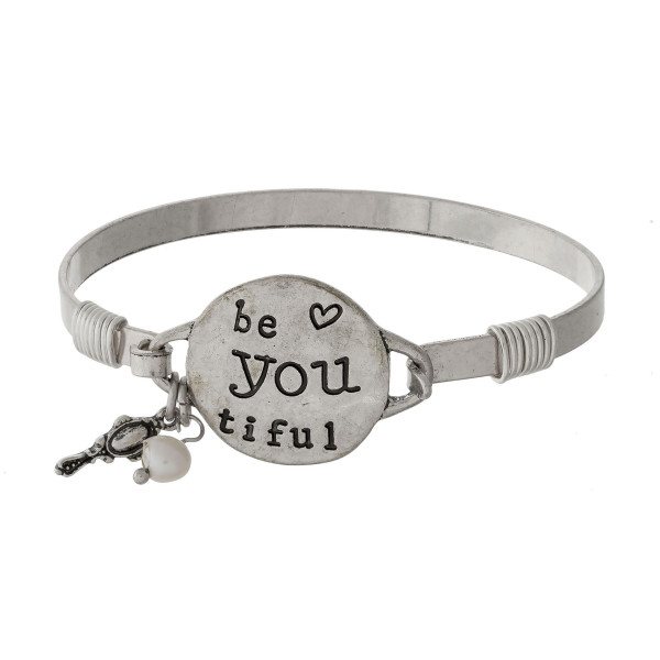 "Bangle bracelet with a circle focal stamped with ""be you tiful"" and an accent charm."