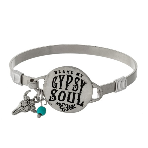 """Bangle bracelet with a circle focal stamped with """"blame my gypsy soul"""" and an accent charm."""
