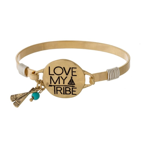 "Bangle bracelet with a circle focal stamped with ""Love My Tribe"" and an accent charm."