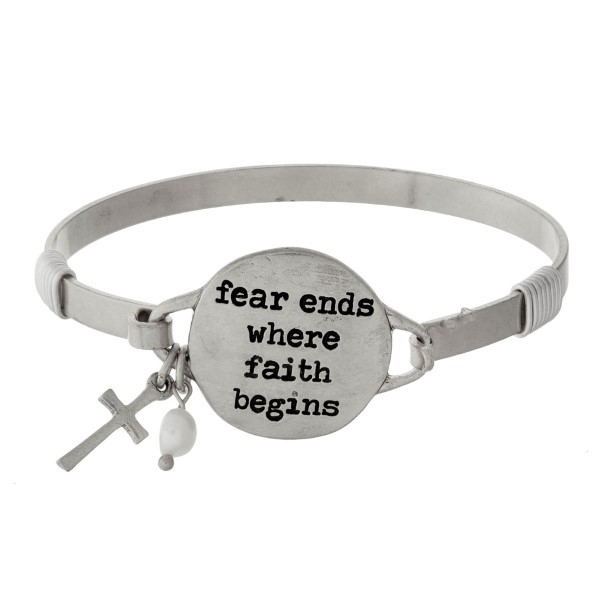 "Bangle bracelet with a circle focal stamped with ""fear ends where faith begins"" and an accent charm."