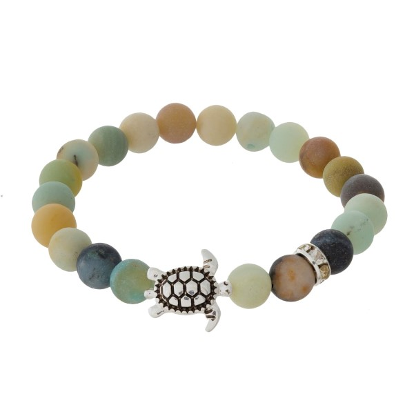 Amazonite, natural stone beaded stretch bracelet with a silver tone sea life charm.