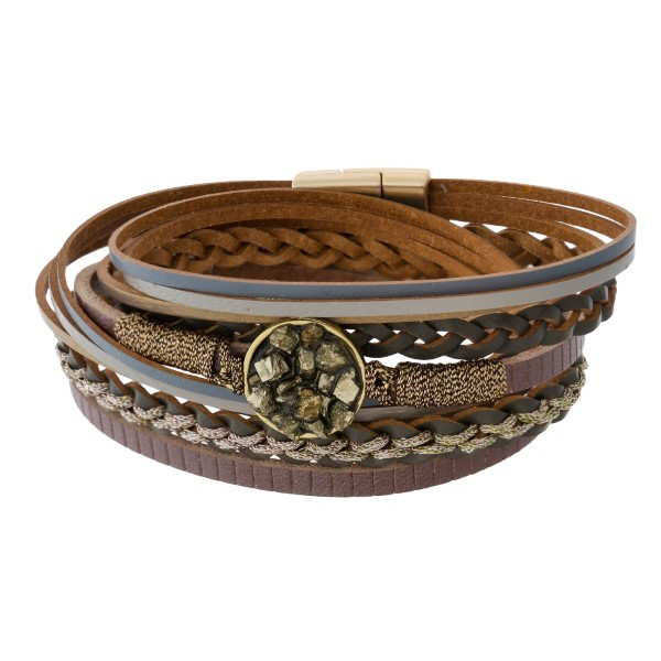 Genuine leather wrap bracelet with a pyrite circle focal and a magnetic closure.