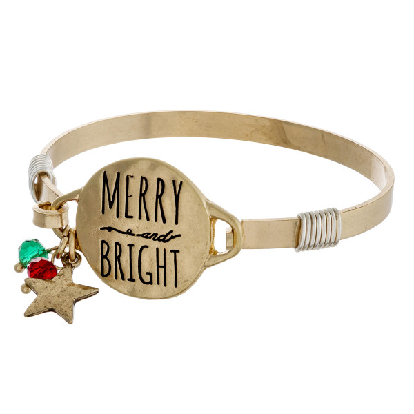 """Merry and Bright engraved gold Christmas bangle charm bracelet with wire wrapped details and hook closure. Approximately 2.5"""" in diameter. Fits up to a 5"""" wrist."""