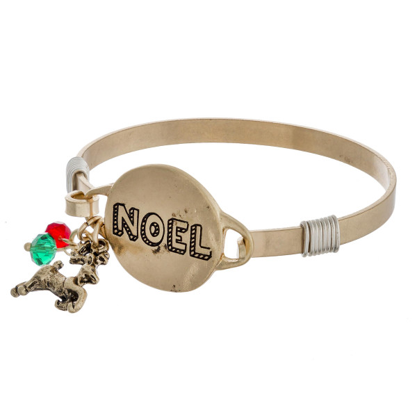 """Noel engraved gold Christmas bangle charm bracelet with wire wrapped details and hook closure. Approximately 2.5"""" in diameter. Fits up to a 5"""" wrist."""