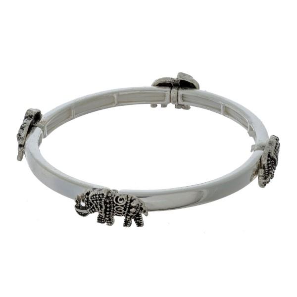 Silver tone stretch bracelet with elephant stationaries.