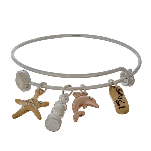 Dainty, silver tone, adjustable bangle bracelet with beach themed charms.