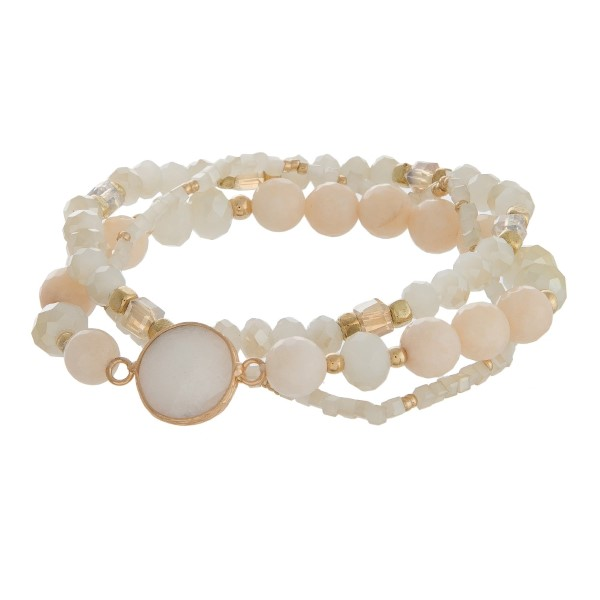 Three piece stretch bracelet set with sparkling beads and gold tone accents.