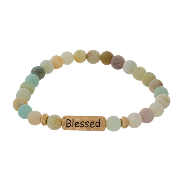 "Natural stone beaded stretch bracelet with a gold tone focal stamped with ""Blessed."""