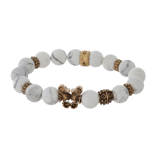 Natural stone beaded stretch bracelet with a gold tone seahorse accent.