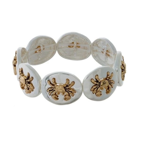 Silver tone stretch bracelet with gold tone sea life focals.