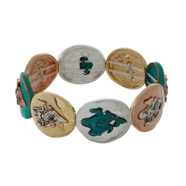 Tri-tone stretch bracelet with gold tone sea life focals.