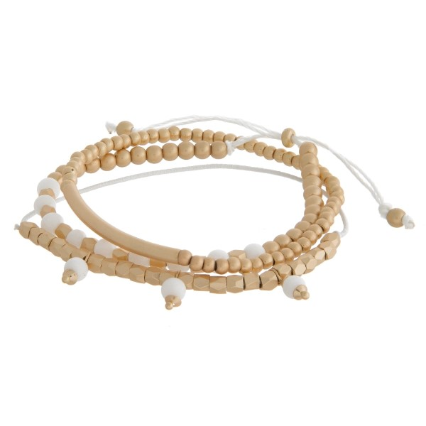 Dainty, natural stone and gold tone beaded, pull-tie bracelet.