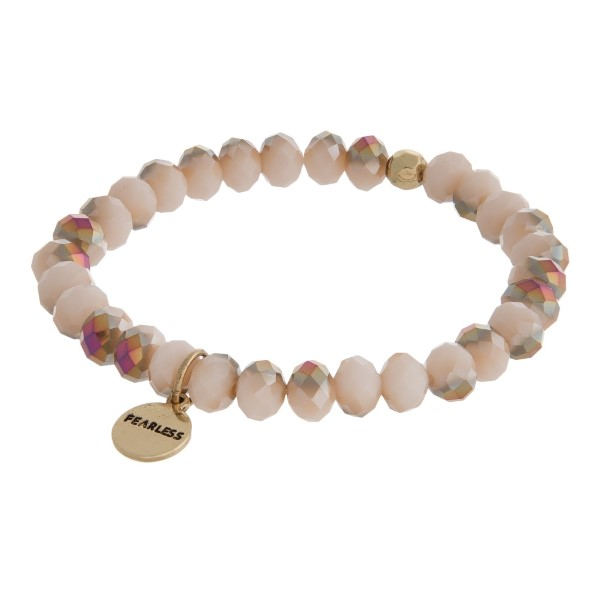 Beaded stretch bracelet with a gold tone circle charm stamped with an encouraging message.