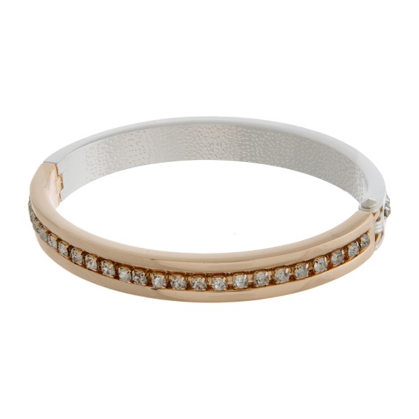 Silver and gold tone bangle bracelet with a hinge closure, and clear rhinestones.